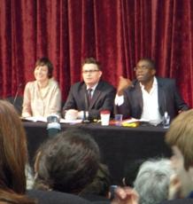 Three people on a debating panel